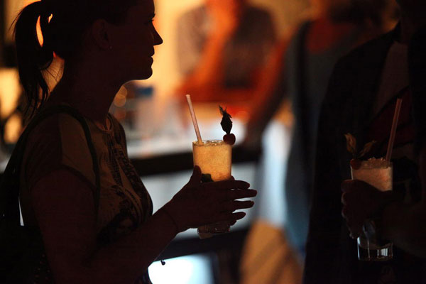 Young lady holding a cocktail in her hands
