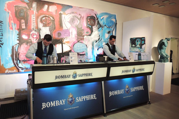 Gin cocktails being served in an art gallery opening