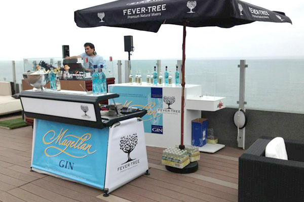 Magellan gin bar in a terrace overviewing the sea