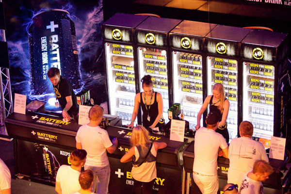 A line of people waits for drinks at the festival energy drink bar