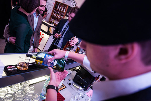 A barman serves whiskey at the Prague Bar Show in 2012