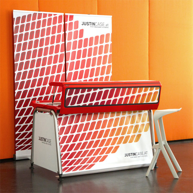 80 cm wide roll up display that creates a back wall for the portable bar and encloses the space, creating a dedicated bar area